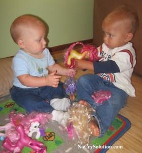 babies sharing toys