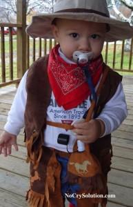 child in cowboy gear
